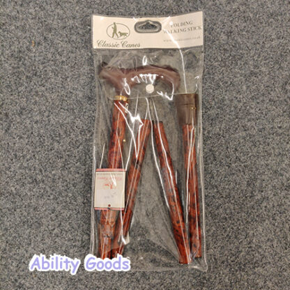 russet orange colour walking stick with gold elements and a brown derby handle
